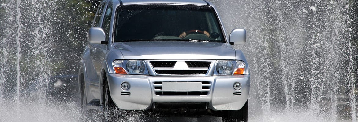 Grey 4wd crossing water with RustStop RS-5 Electronic Rust Protection