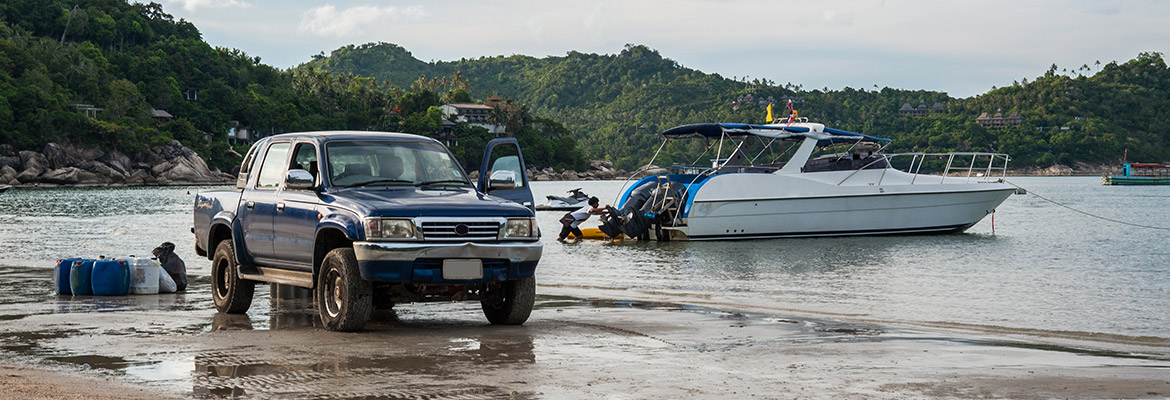 Blue Double Cab and Boat on Beach with RS-5 Rust Protection